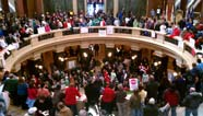 Pro-worker protesters in Wisconsin capitol rotunda